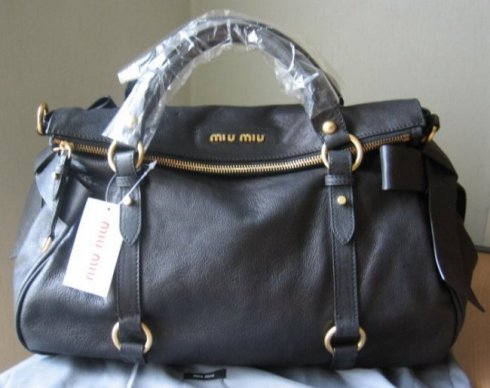 65268c7c457a ... Miu Bow Satchel with the new silver hardware. A replica bow satchel